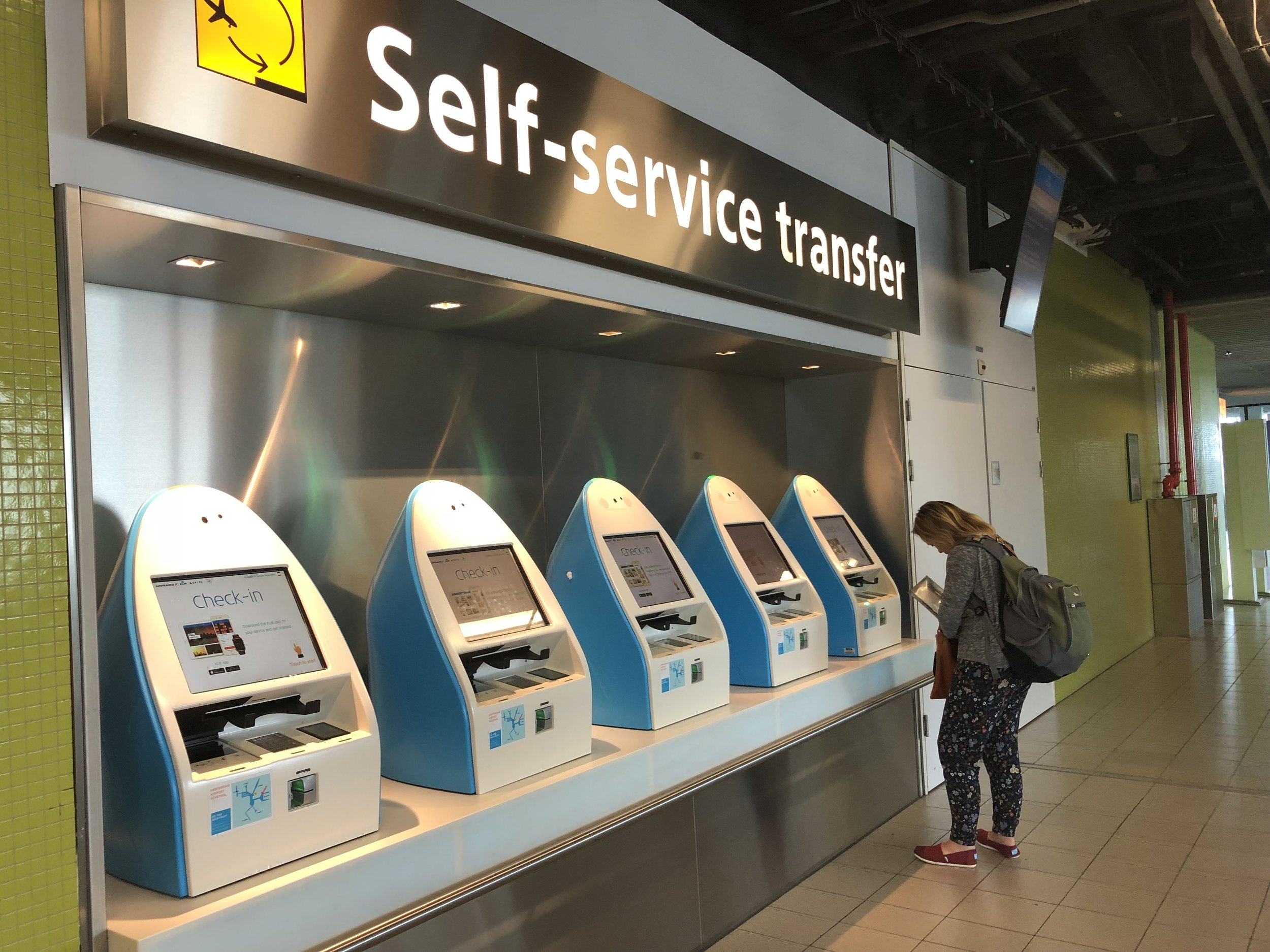 Self Service Transfer - Need to check in for your connecting flight... plenty of automated check-in machines along the way... There are also staffed areas for help if you need it...
