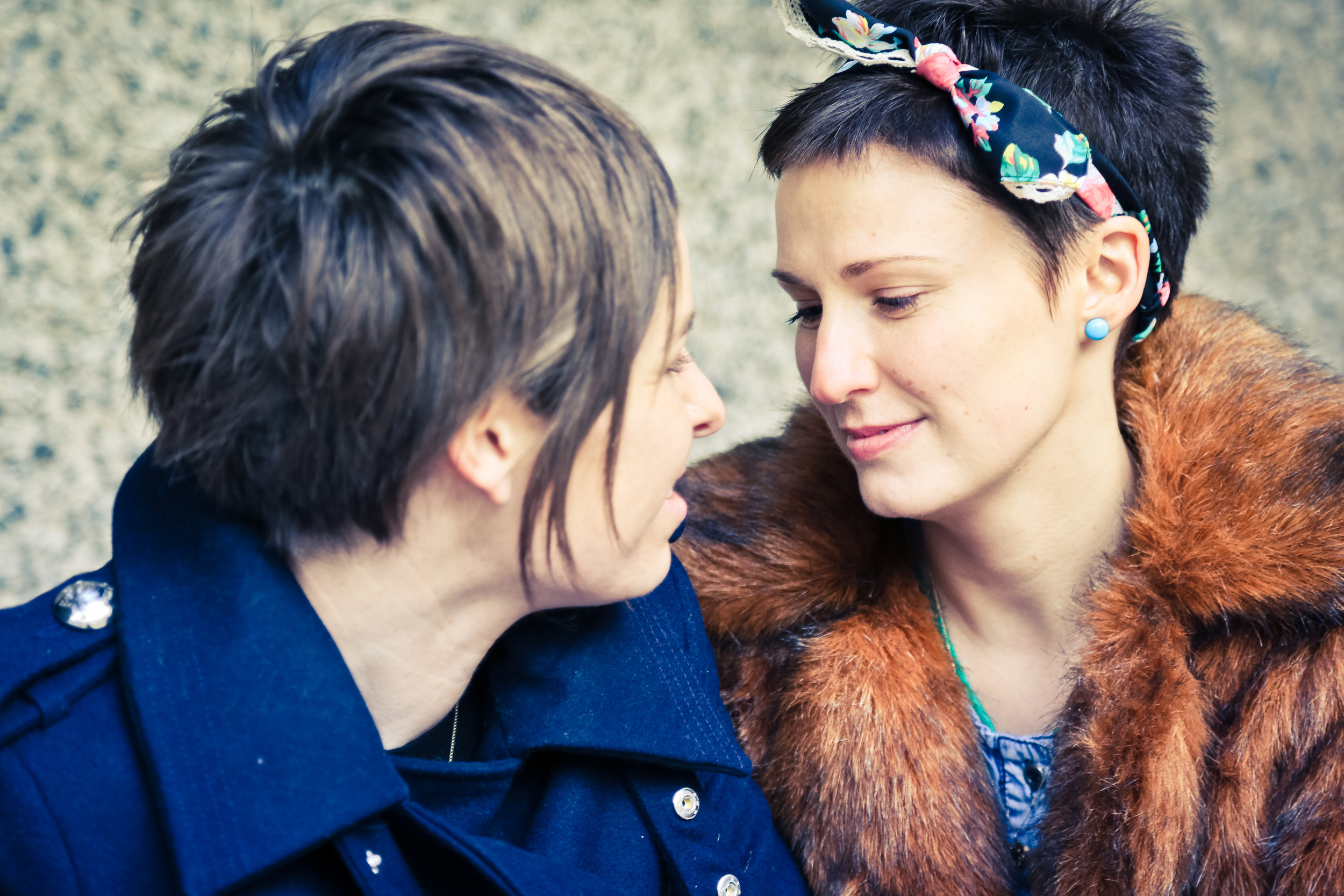 Gay couple tender look engagement photography