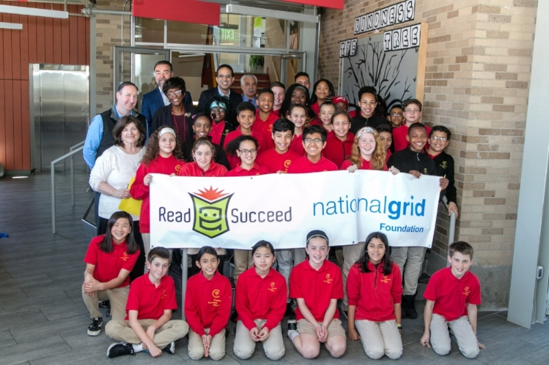 Supporters from the National Grid Foundation, The Warren Alpert Foundation and Rhode Island Department of Education join rising 4th and 5th grade students at Community Preparatory School