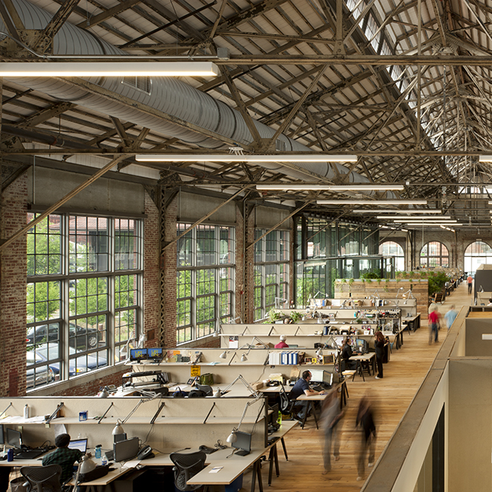 Each of URBN's buildings were once military factories, which one can easily see to this day.They repurposed concrete, doors, steal beams, even cranes to create the decor inside massive brick structures with floor-to-ceiling windows.