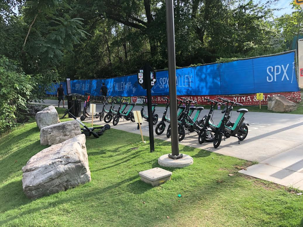"""A """"nest"""" of scooters on Atlanta's Beltline in Inman Park."""