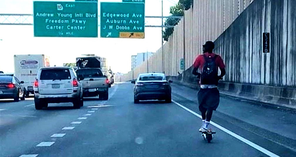 A man caught riding an e-scooter on the highway in Atlanta.