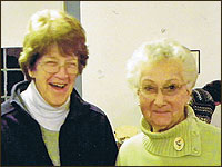 Long time members Louise Knapp and Elizabeth Winslow enjoy a historic moment at the annual meeting.