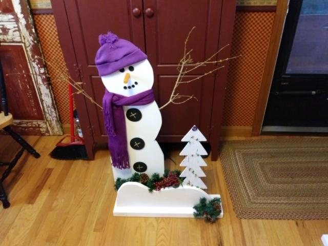 This snowman stands more than three feet tall; a sample of the holiday crafts that will be on sale at the fair !