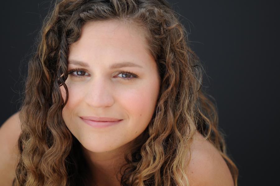 Ashley Teague,  Director