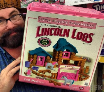 man-holding-pink-lincoln-log-box.jpg
