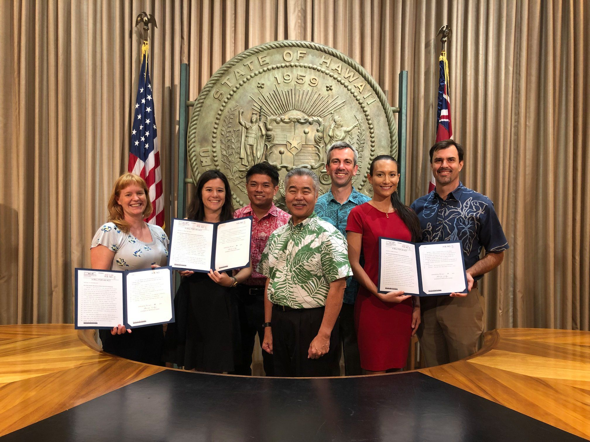 Jodi (pictured in red) joined Governor Ige and friends from Ulupono Initiative, Elemental Excelerator, and the Honolulu Office of Climate Change, Resiliency, and Sustainability for the 2019 environmental bills signing, where 7 bills were signed into law.