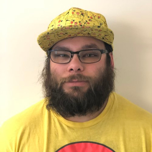Portrait of Tino wearing a yellow hat and t-shirt.