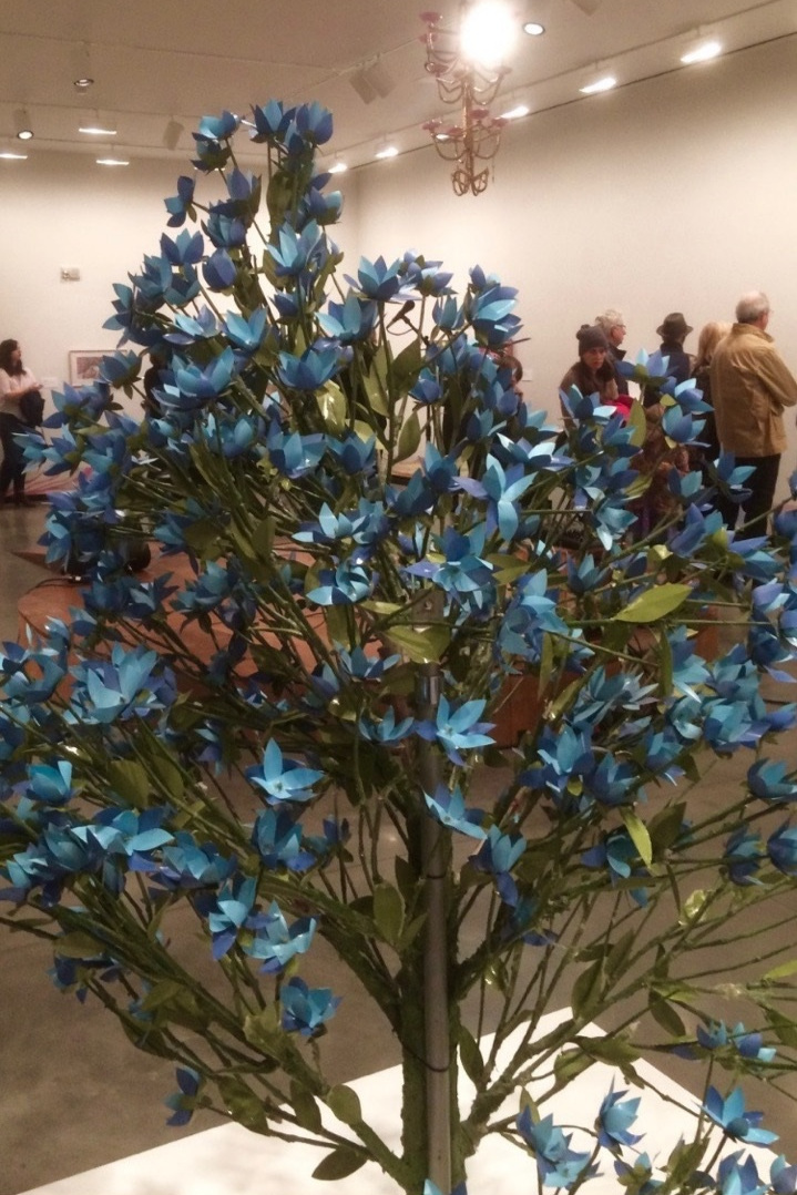 Close-up image of a bouquet of blue flowers individually made of paper by Lawrence. Photo courtesy of the artist.