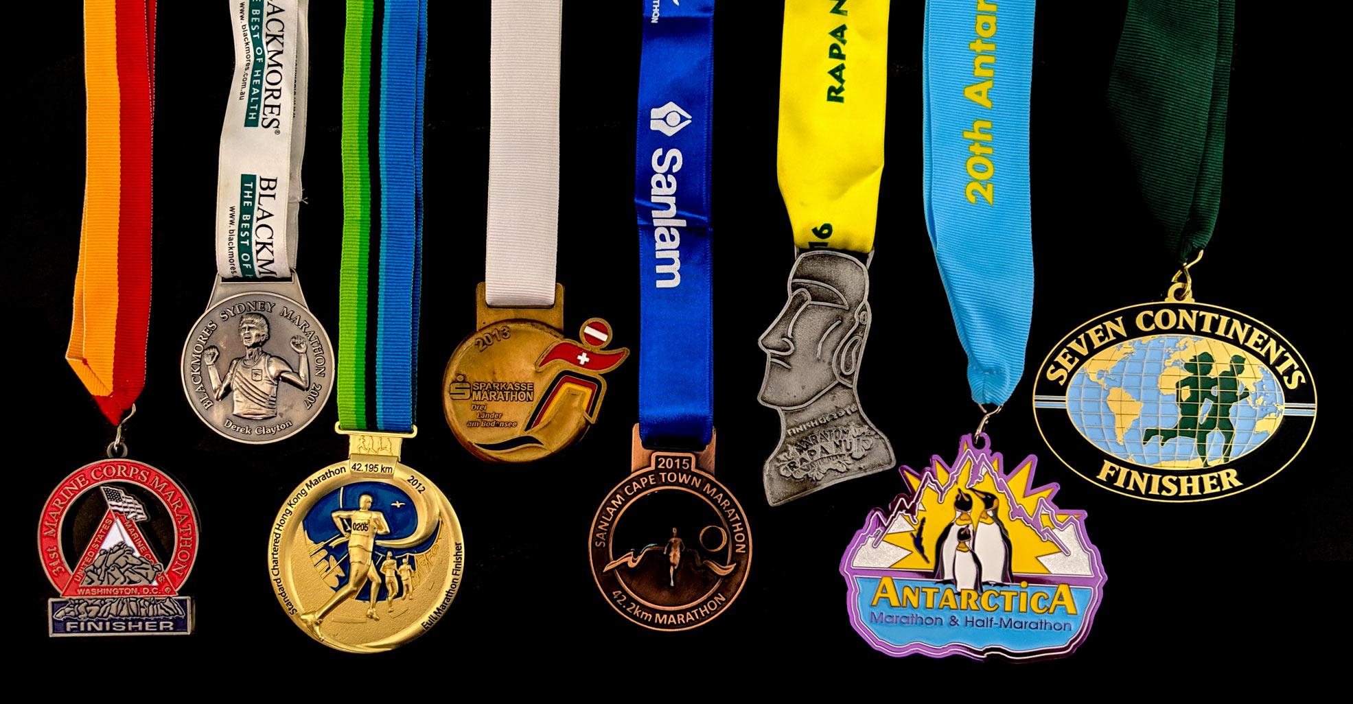 Halef's seven continents medals (from left to right): 2006 Marine Corps Marathon (North America), 2007 Blackmores Sydney Marathon (Australia), 2012 Standard Chartered Hong Kong Marathon (Asia), 2013 Sparkasse Bodensee Marathon (Europe), 2015 Sanlam Cape Town Marathon (Africa), 2016 Rapa Nui Marathon (South America), 2019 Antarctica Marathon (Antarctica)
