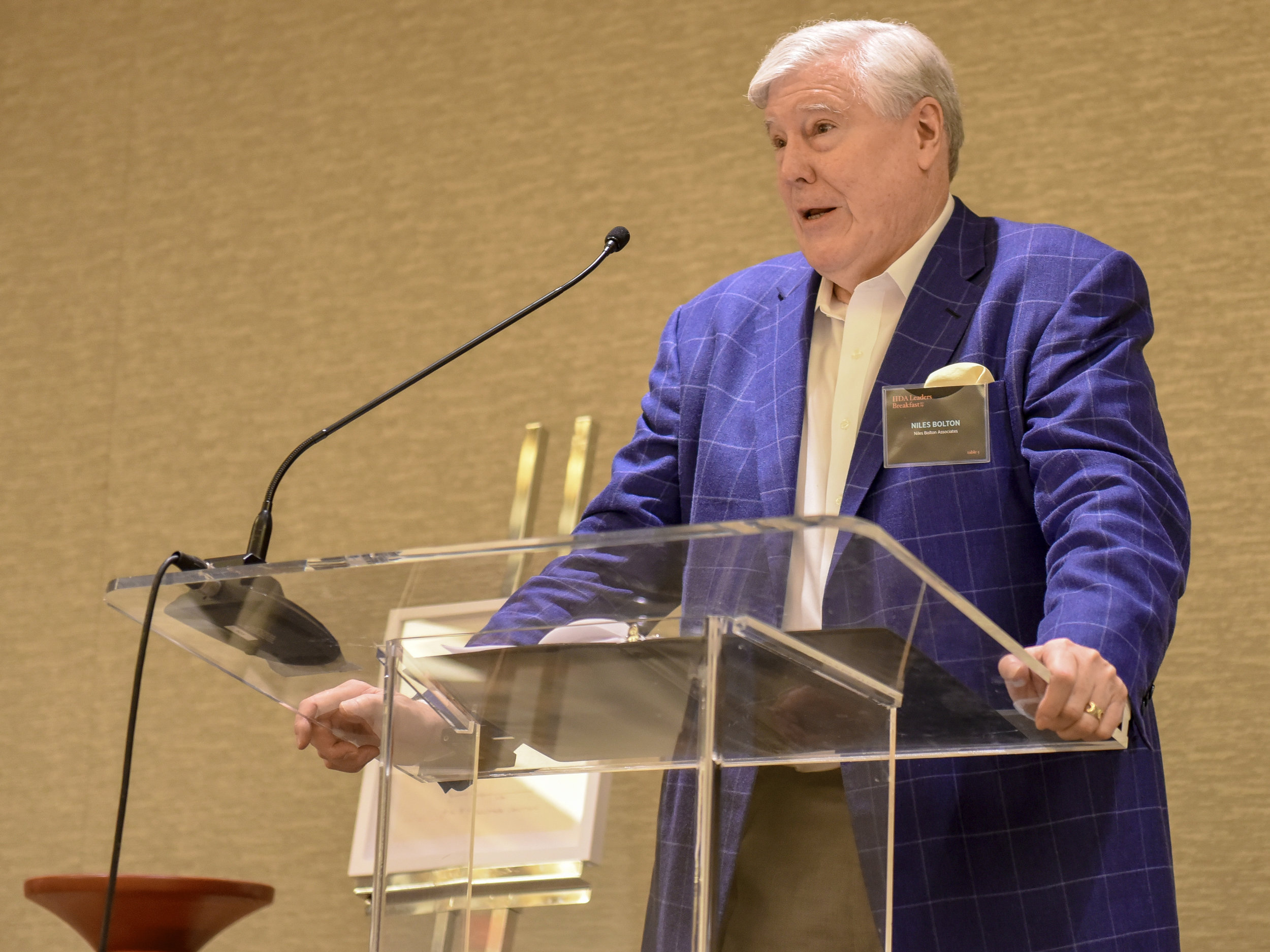 Chairman and CEO, Niles Bolton, giving an introduction speech for Stephanie