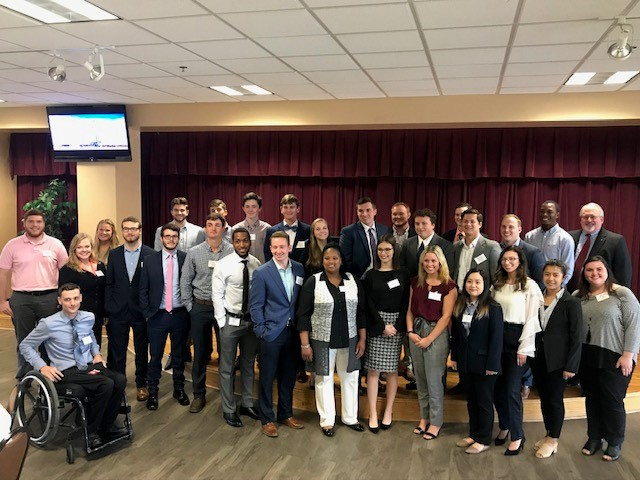Risk Manager in Residence Program at University of Louisiana - Monroe: Michael Phillipus (2nd row on the right end) with a group of our students after a lunch. More than 60 students attended his lunch presentation. He also spoke to more than 100 students in the Business 1001 class, 18 in the Business Risk Management class and more than 70 people at a reception that the Spencer grant sponsored.