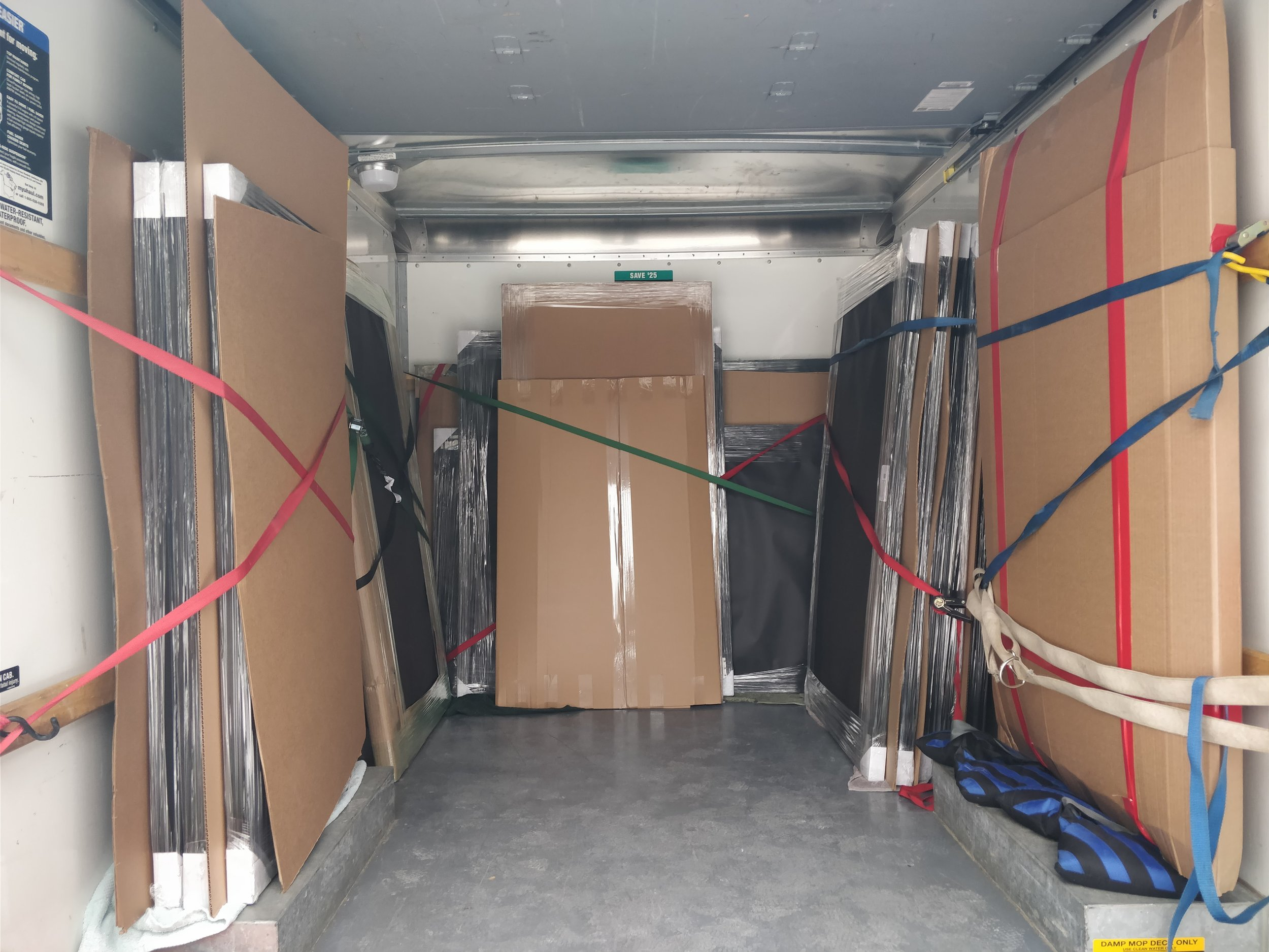 """Check out the delivery van loaded up with 16 custom photos ready for delivery! Photos ranged in size up to 60""""x40""""... What a busy day!"""