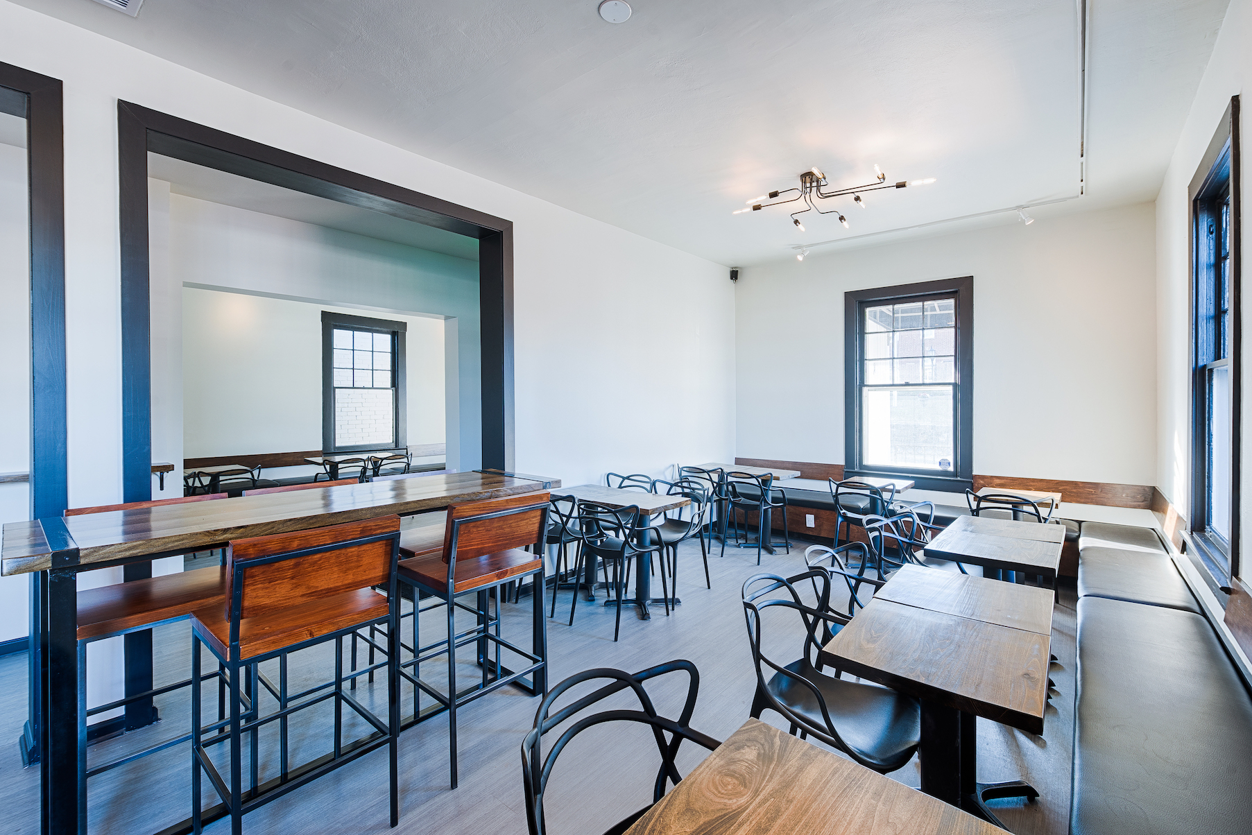 Main dining area - With the combination of high top tables and regular seatings, this open space dining room highlights the historic building with a modern and intimate touch.