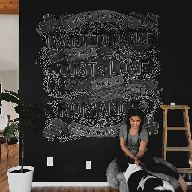 """If you haven't danced semi-aggressively to Four Simple Words by @frankturner , you aren't living your best life. ⠀ I've been quiet on here the last month and now I'm back with SO many exciting projects to share. Starting with actual evidence that I still have a chalkboard wall and I still love drawing on it (see the blog post link in my profile for making your own wall)! Everyone needs a chunk of wall they can draw on, right? ⠀ I'm happy with how this one turned out, despite all the flaws I see in it and the the fact that it's a few degrees crooked. One of my all-time artists/letterers/cool-humans inspirations is @stefankunz and """"create something every day even if it sucks"""" is the best way to take on life as a creative person. And I'm embracing my slow progress in lettering but am constantly bombarded by inspiration following amazingly skilled humans like @ianbarnard @lisa_quine and @homsweethom - you will die from love for their feeds and come back as a self-drawing pencil. ⠀ Anyways. Go listen to some frank and tell me your new favorite song. ⠀ #chalkboardwallart #letteringlove #chalkboardwall #chalkboardart #yeghomes #igwallsofyeg #yegwomen #yegdesign #yegliving #edmontonliving #edmontonhomes #canadianbloggers #canadiancreatives #yegdesigner #yegartist #yegbusiness #frankturner #foursimplewords #iwanttodance #graphicdesignblg #graphicdesigner #handletterer #chalkart #chalkartists"""