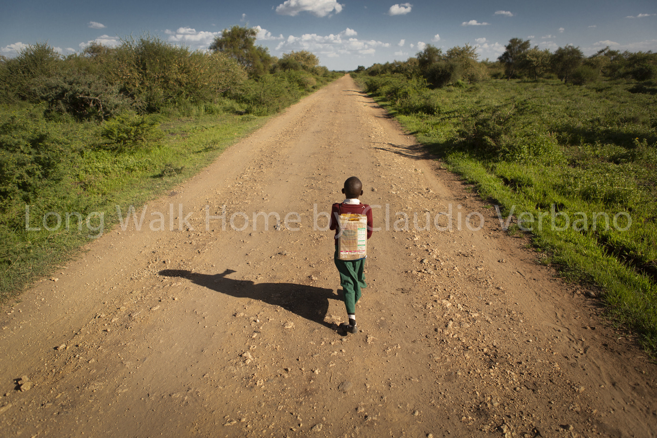Ten year old Pendo on her daily way to school. Everyday she has to walk about 40 kilometers to school and back home for her education.