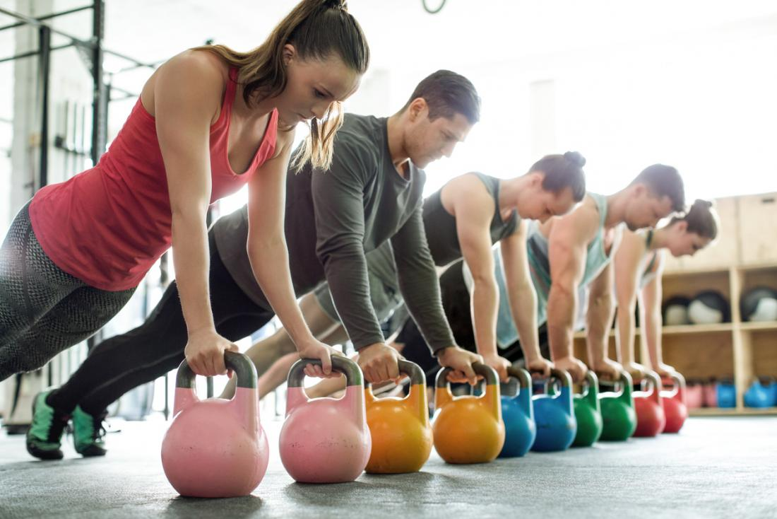 group-in-a-gym-performing-strength-training-exercises-to-stay-fit.jpg