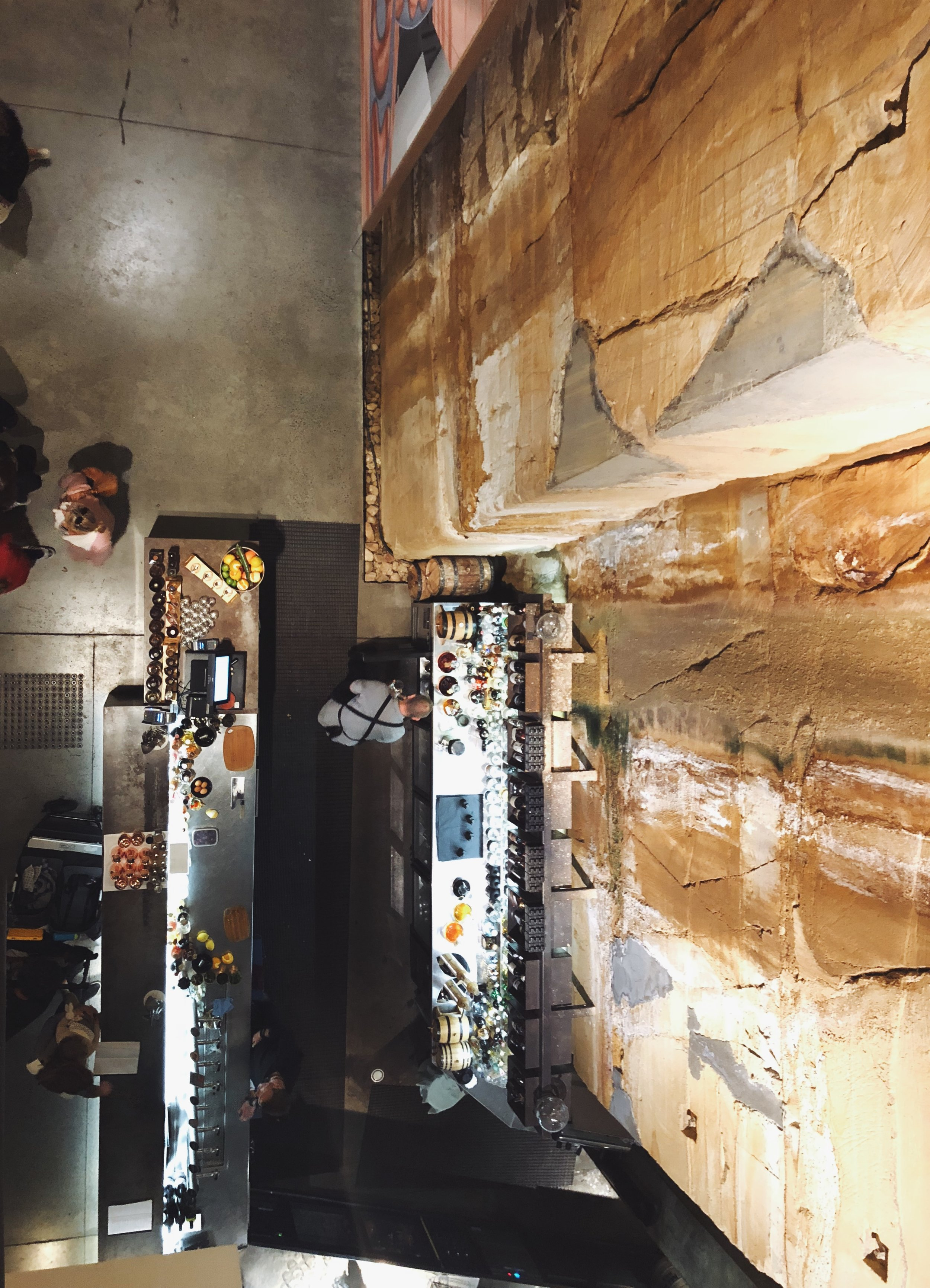 - After we purchased our tickets, we descended down a spiral staircase about 3 floors underground. The walls are covered with a rocky façade which serves as a constant reminder that you're underground.