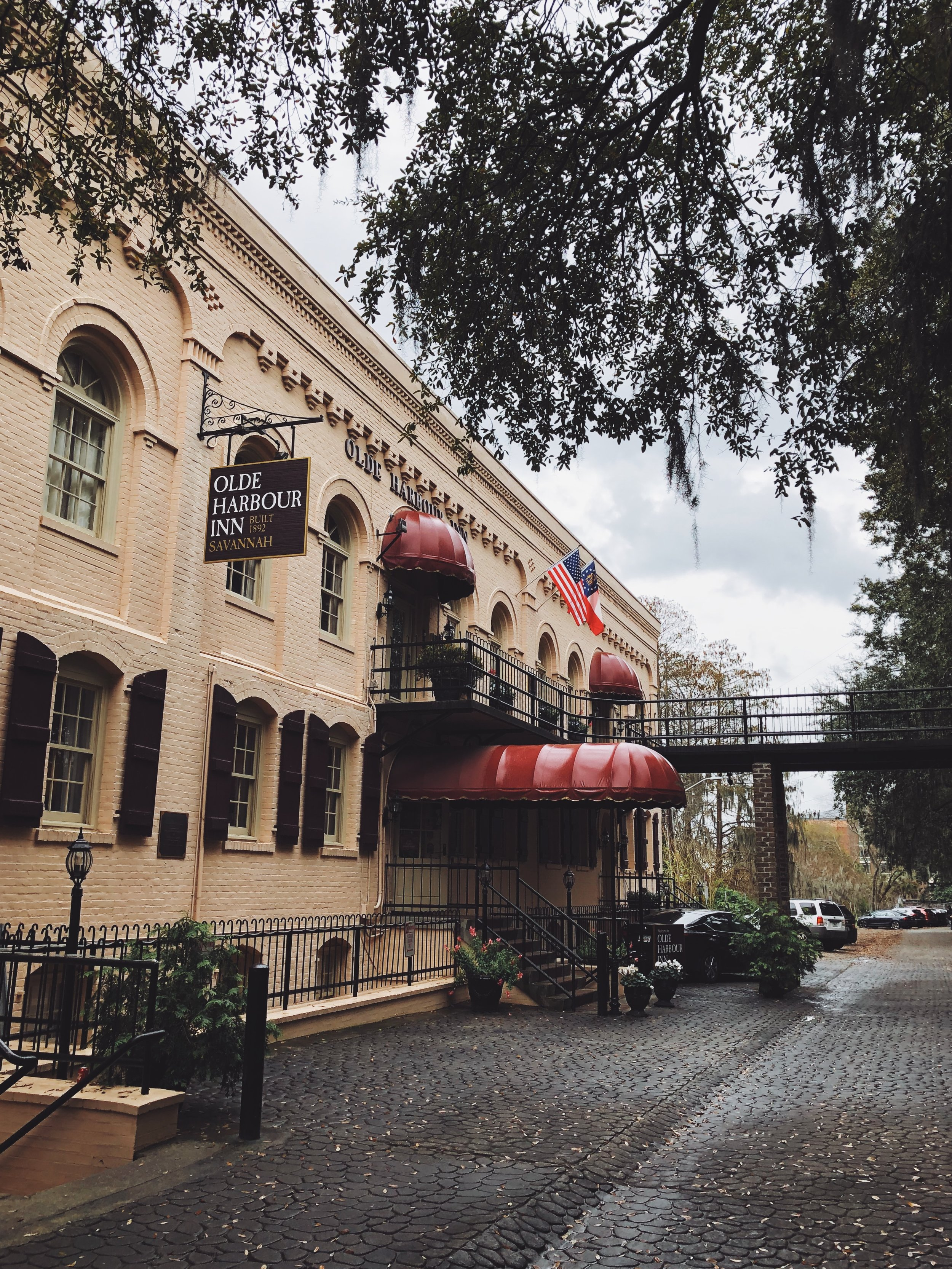 - Our hotel in Savannah, The Olde Harbour Inn, was so charming! It was right next to the riverwalk, which is a cute (touristy) area of town to walk around. There was lots of live music spilling out of the bars at night (but we couldn't hear it from our hotel room!)