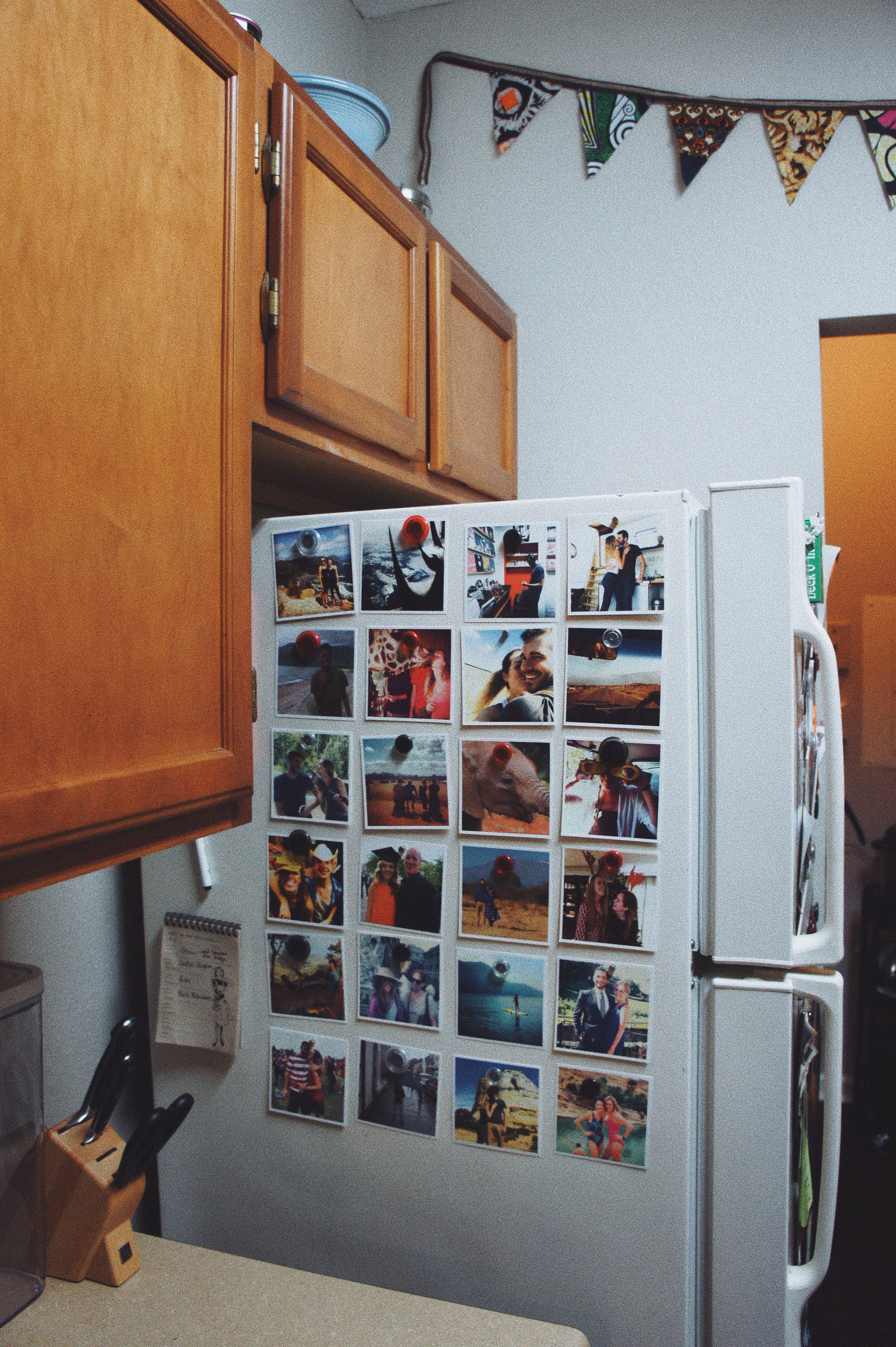 - Our kitchen isn't much to write home about— it's small and practical and we're in a rental so we can't do much in there anyway! But, I love this little photo wall that we made on the side of our fridge, with lots of memories from 2014/15 when I had them printed. I have been on a huge organizing kick and am adding lots of bins to our pantry. My next purchase is going to be this tea box from Amazon, I think we'll need a couple!