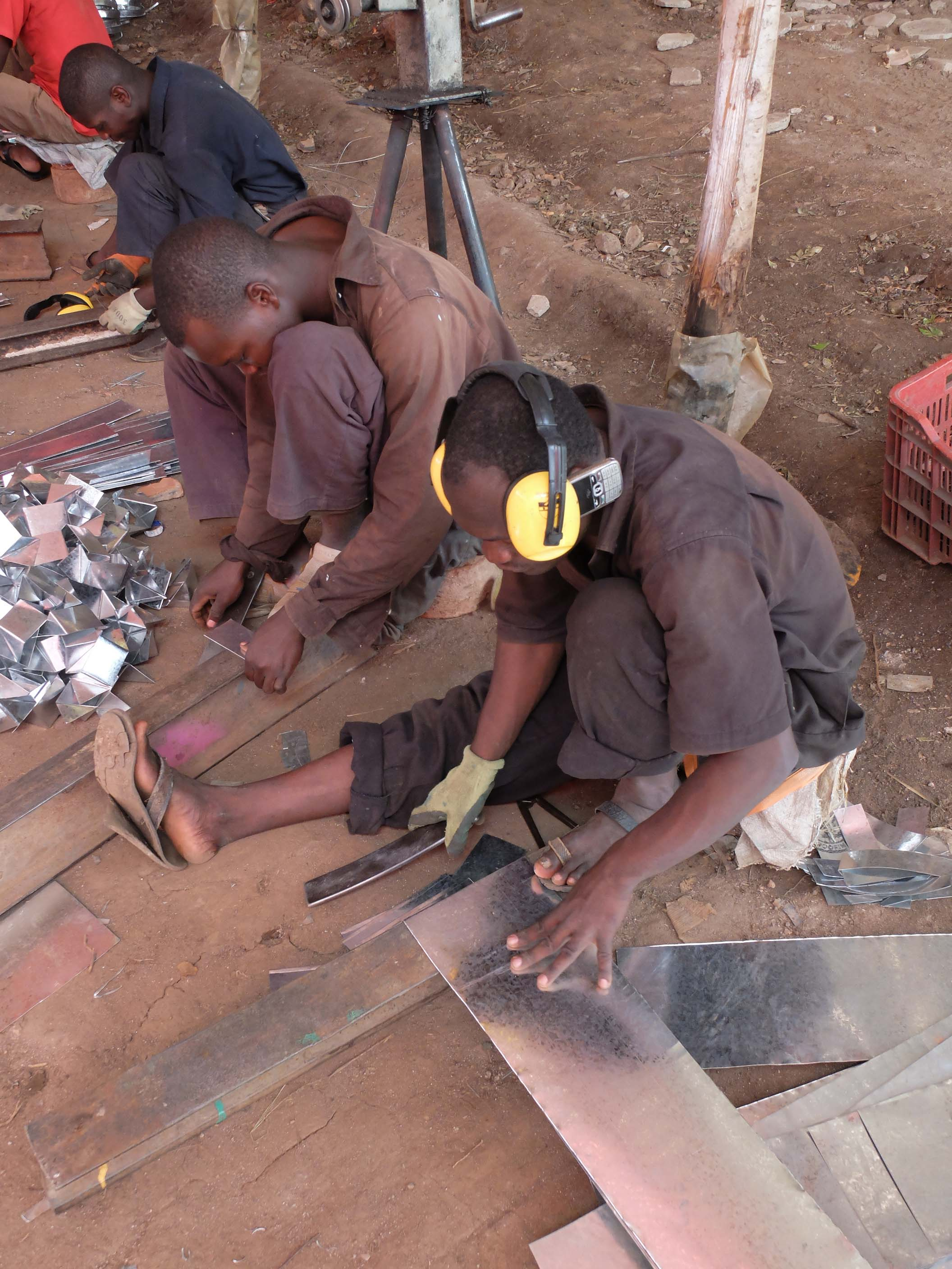 1503-GBE-artisans working in stove.jpg
