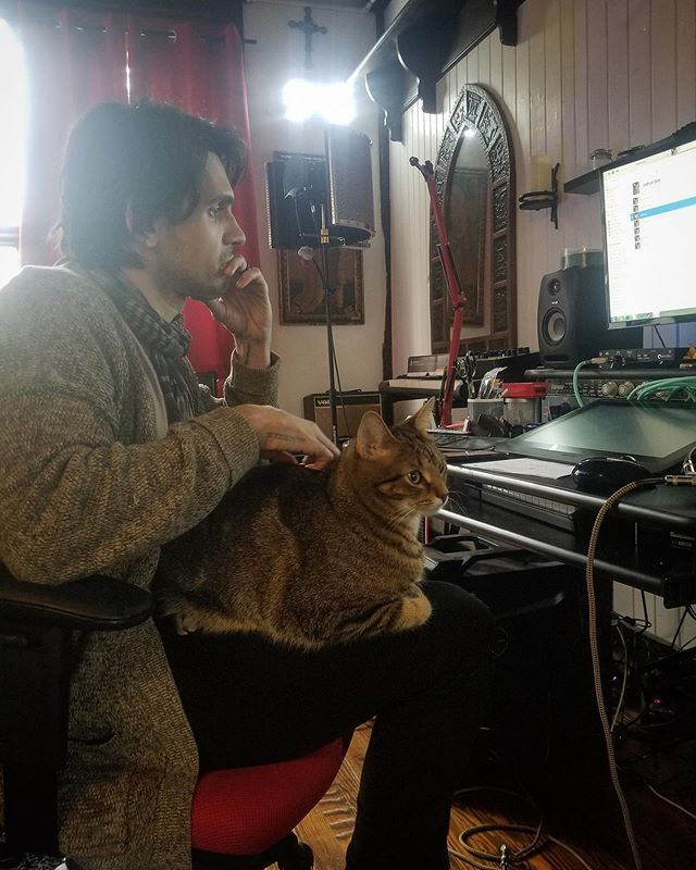 @buggothecat listening to the arrangement of our next album to make sure that it flows, and definitely not just trying to hear if there is a bat in the attic (Edit: that cross is there to scare away the vampires 🧛♀️ 🧛🏿♂️)