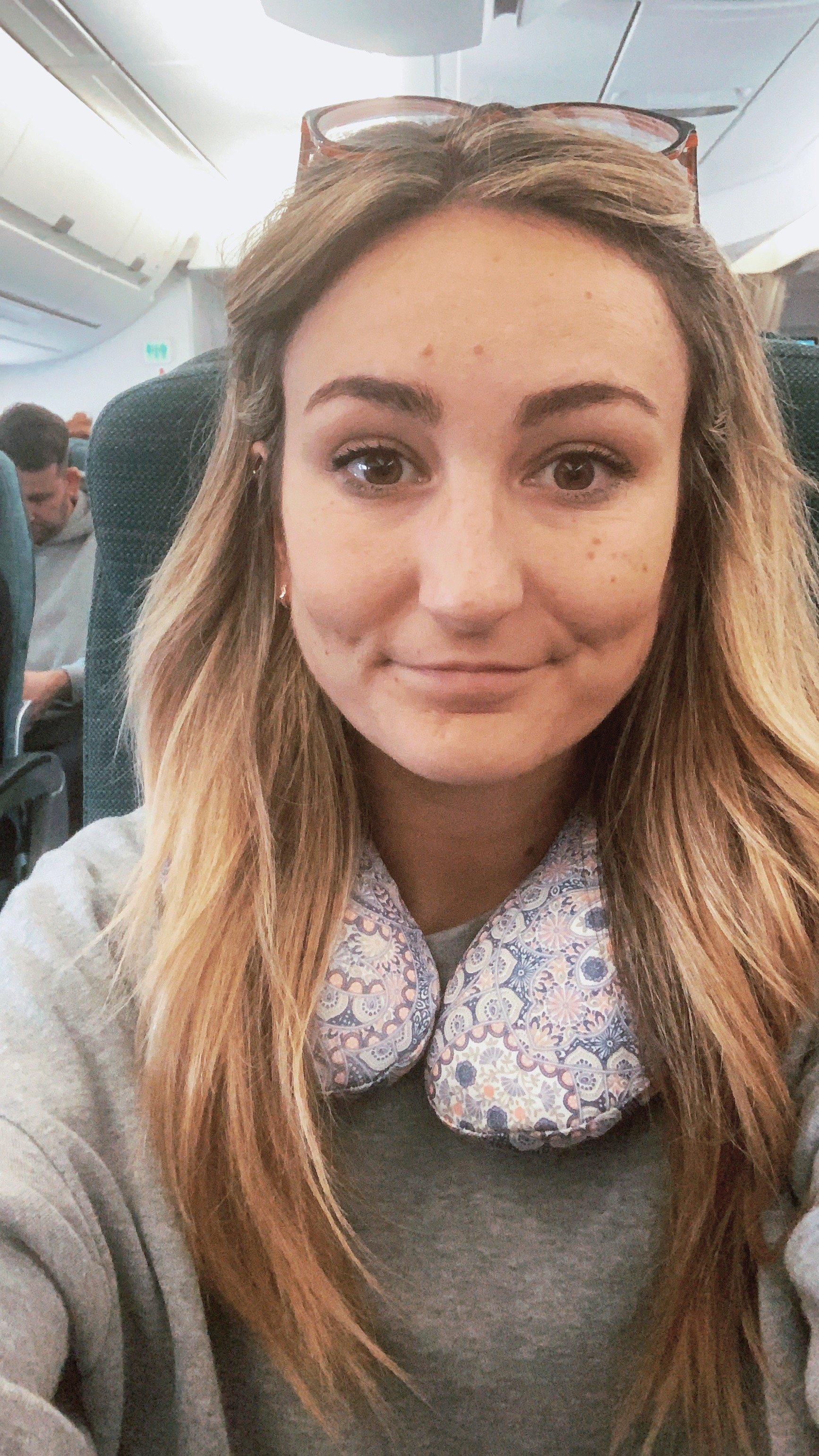 selfie with kneck pillow on long haul flight from London to Australia March 2019
