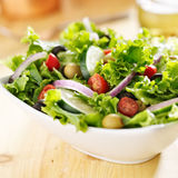 bowl-leafy-green-salad-olives-tomatoes-cucumber-41762531.jpg