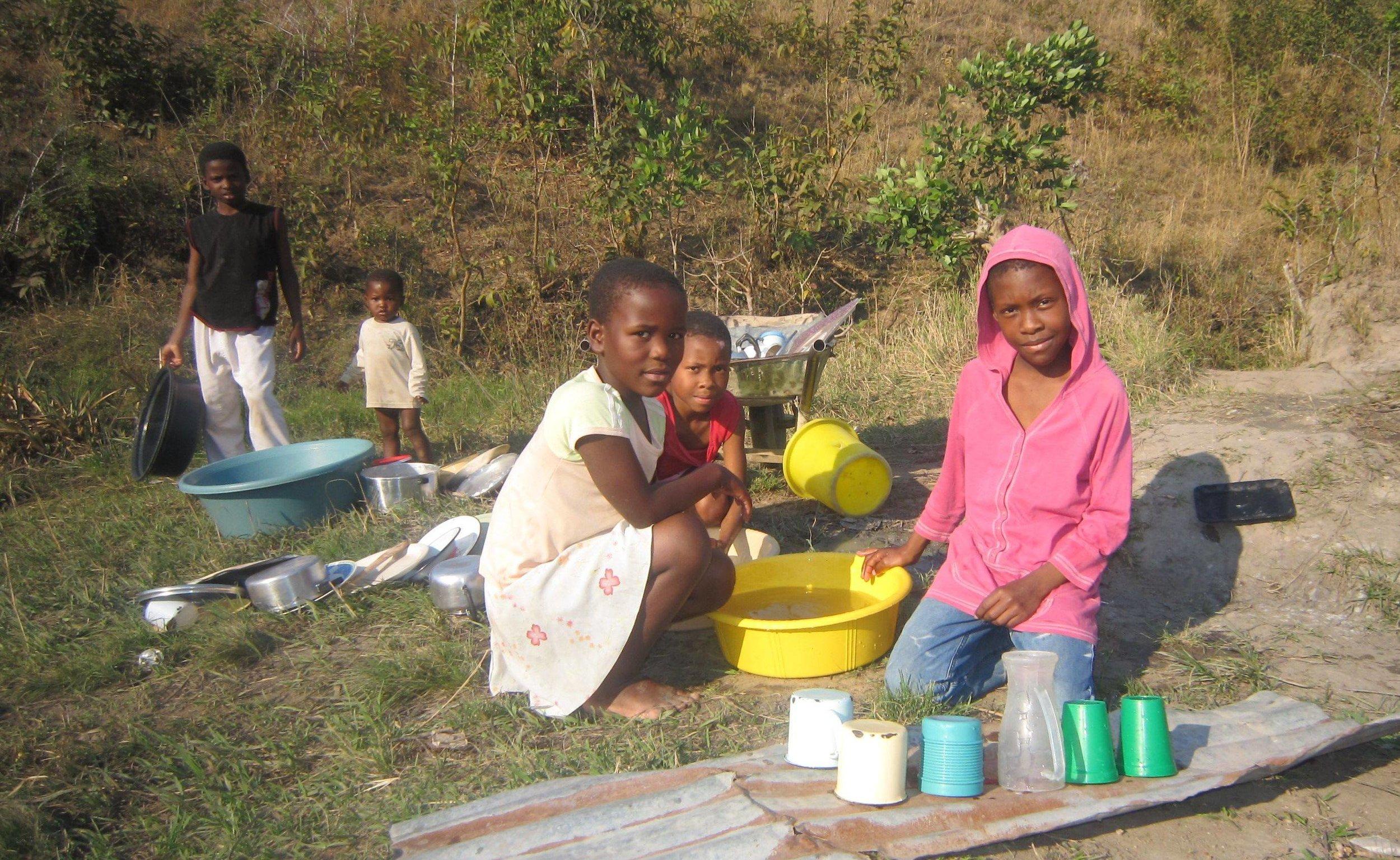 Rocket Kids children washing dishes.jpg