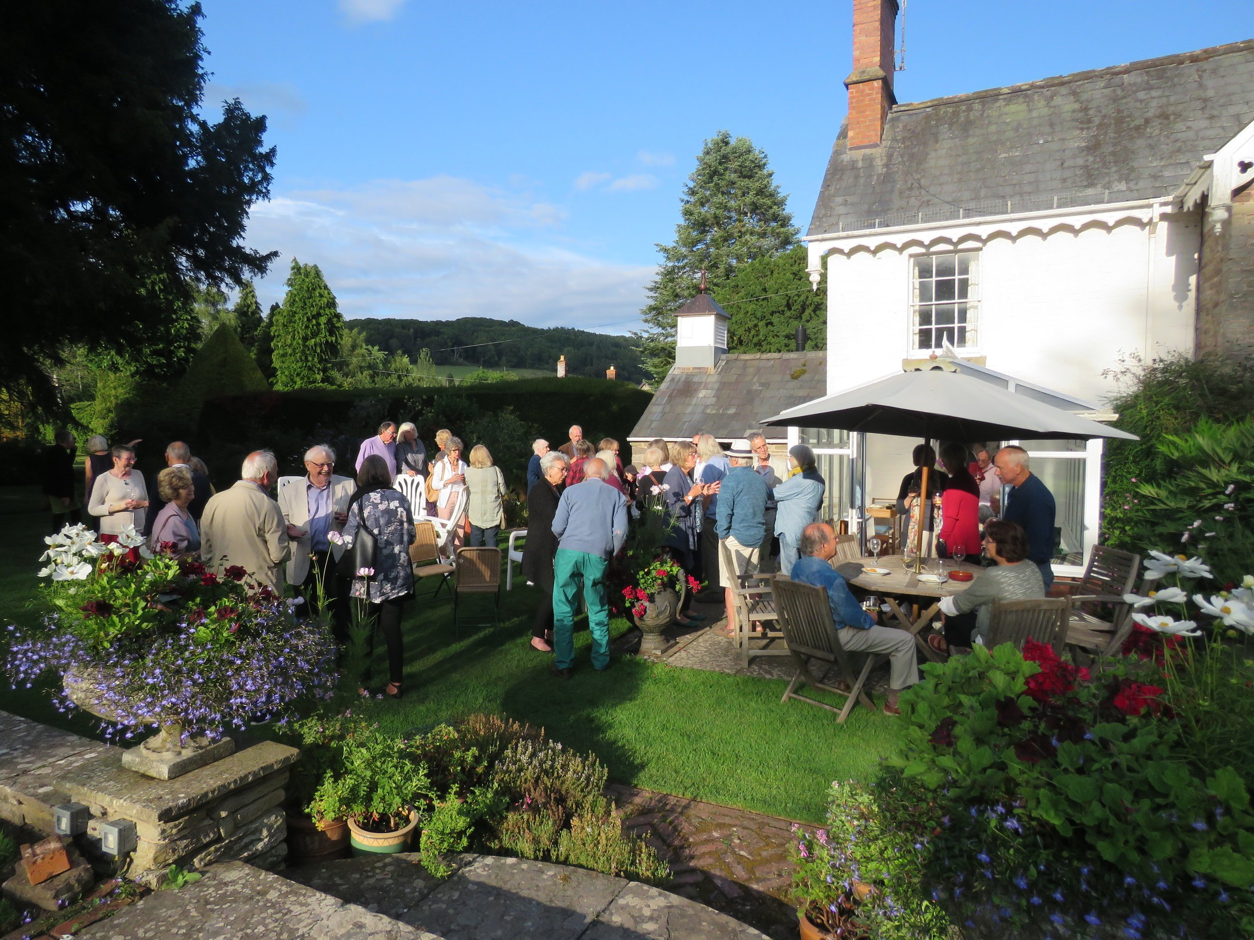 Members of the audience enjoying a glass of wine in the garden at Dorstone House after 'Private Passions'
