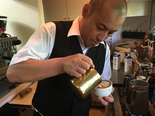 Barista preparing a cup of cafe latte