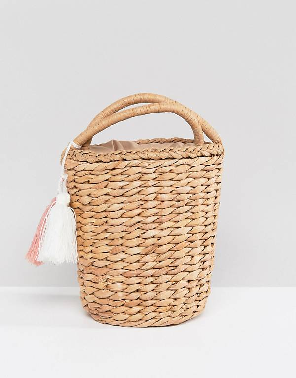 http://www.asos.com/glamorous/glamorous-circular-straw-bag-with-tassel/prd/9262720?clr=natural&SearchQuery=straw%20bags&gridcolumn=1&gridrow=3&gridsize=4&pge=1&pgesize=72&totalstyles=27