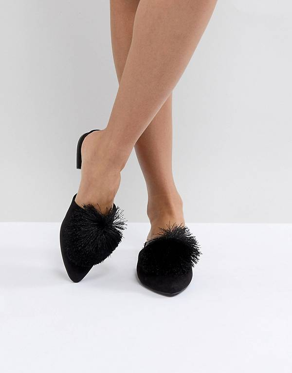 http://www.asos.com/truffle-collection/truffle-collection-pom-mule-shoe/prd/8930703?clr=blackmicro&SearchQuery=mules&gridcolumn=4&gridrow=9&gridsize=4&pge=2&pgesize=72&totalstyles=119