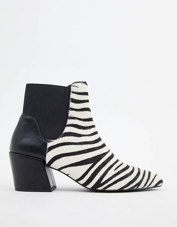 https://www.asos.com/au/stradivarius/stradivarius-zebra-print-boot/prd/10975744?clr=black&SearchQuery=zebra&gridcolumn=3&gridrow=6&gridsize=4&pge=1&pgesize=72&totalstyles=142