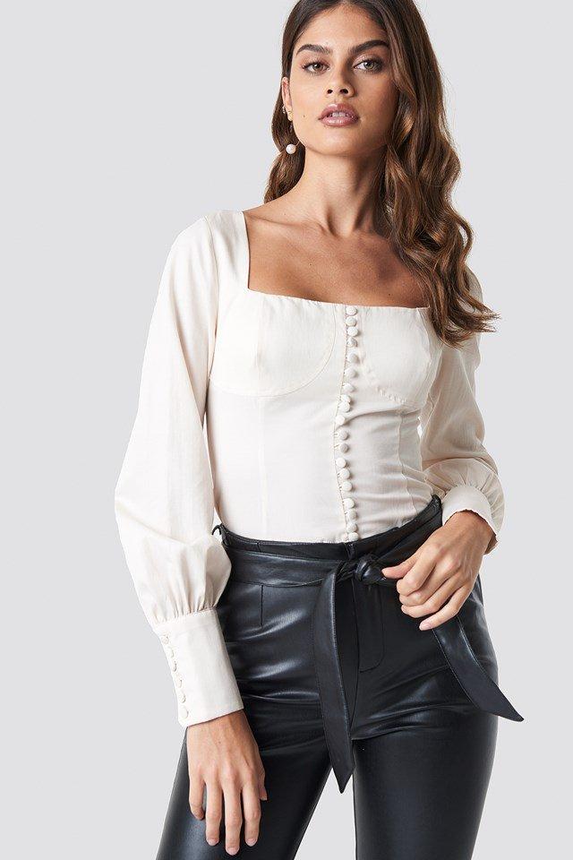 https://www.na-kd.com/en/luisalionxnakd/corset-blouse-cream