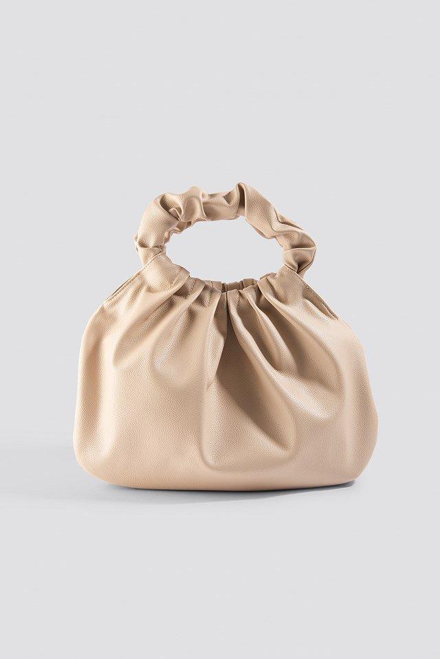 https://www.na-kd.com/en/na-kd-accessories/ruffled-handle-handbag-beige