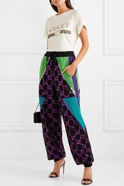 https://www.net-a-porter.com/ca/en/product/1084541/Gucci/sequin-embellished-wool-track-pants-