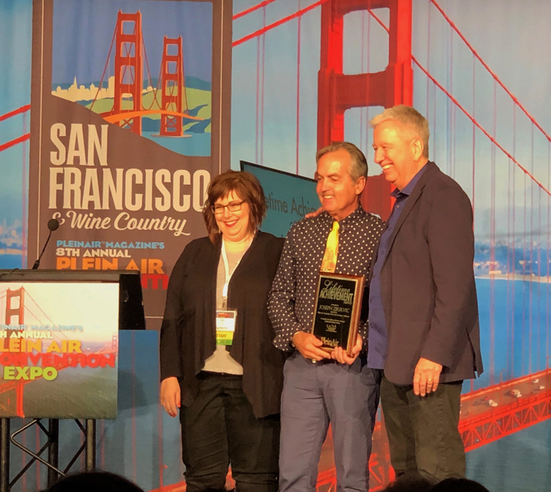 Editor of Plein Air Magazine and Publisher of Plein Air Magazine, Kelly Kane and Eric Rhoads, Presenting Joseph Zbukvic with a Lifetime Achievement Award