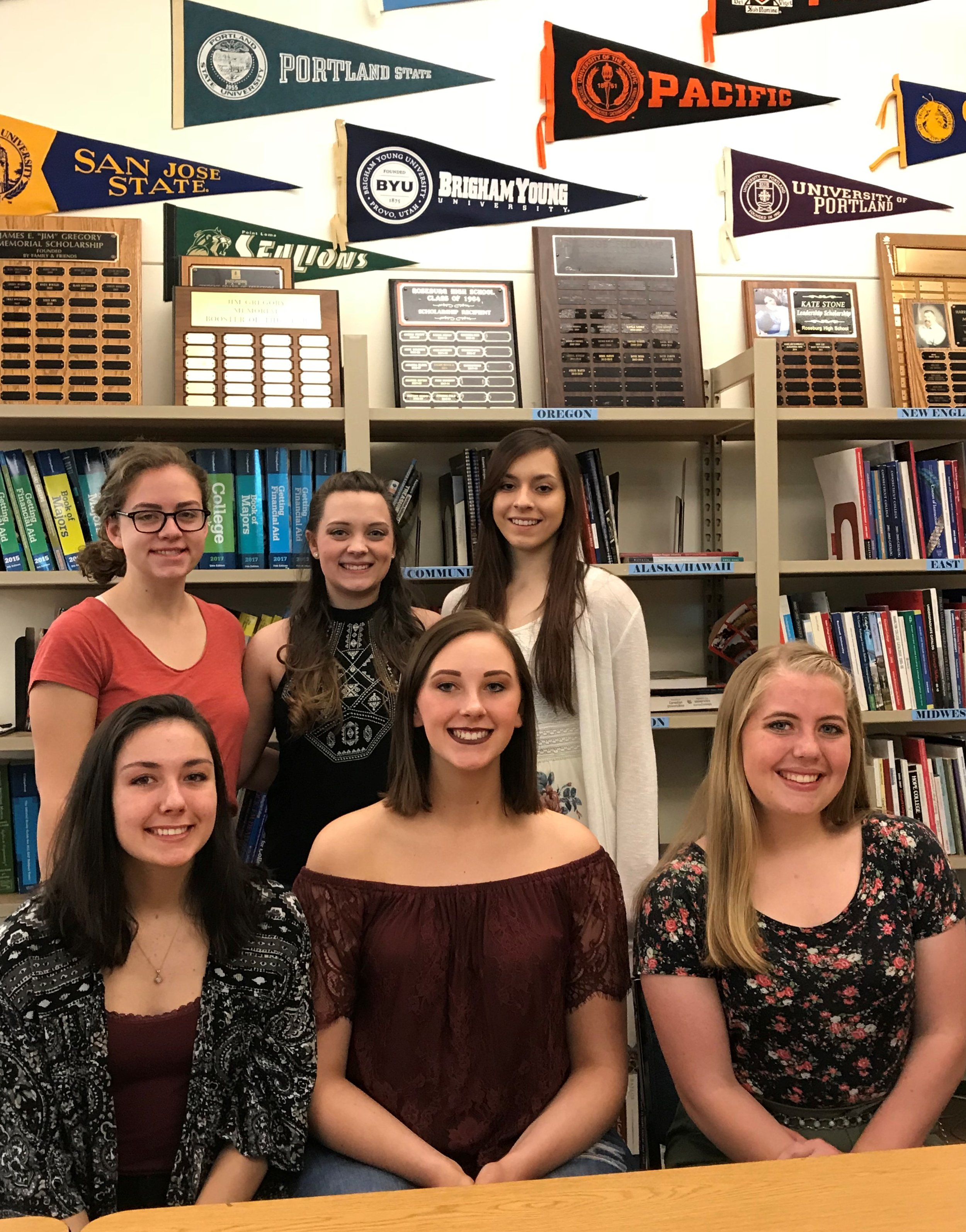 "Pictured in the RHS Career Center are (seated) Erin Ware, Jenna Smith, Grace Harker; (standing) Alison Forsloff, Madison Coffey and Hannah Wicks. Alexandria Cortes and Madison Severson unfortunately missed the photo due to participating in the Blood Drive that morning.             72     544x376                Normal     0                         false     false     false         EN-US     X-NONE     X-NONE                                                                                                                                                                                                                                                                                                                                                                                                                                                                                                                                                                                                                                                                                                                                                                                                                                                                                                                                                                                                                                                                                                                                                                                                                                                                                                                                                                                                                                                                                                                                                                                                                                                                                                         /* Style Definitions */  table.MsoNormalTable 	{mso-style-name:""Table Normal""; 	mso-tstyle-rowband-size:0; 	mso-tstyle-colband-size:0; 	mso-style-noshow:yes; 	mso-style-priority:99; 	mso-style-parent:""""; 	mso-padding-alt:0in 5.4pt 0in 5.4pt; 	mso-para-margin:0in; 	mso-para-margin-bottom:.0001pt; 	mso-pagination:widow-orphan; 	font-size:10.0pt; 	font-family:""Times New Roman"",serif;}          FOR IMMEDIATE RELEASE  APRIL 25, 2018  Contact: Karen Goirigolzarri, 541-430-4142,  Kgoirigolzarri35@gmail.com     RHS Foundation announces 2018 scholarship winners    The Roseburg High School Foundation announces eight student winners in the first year of scholarship awards made by the newly reorganized independent, nonprofit organization, formerly the Roseburg Indian Booster Club.  Karen Goirigolzarri, Foundation vice-president and chair of the Scholarship Committee, congratulated the winners at a gathering in the RHS Career Center on Wednesday. Students submitted applications in March including information about their GPA, school/community activities, career aspirations and letters of recommendation. After its review process, the Foundation awarded 2 scholarships at $1,000 each and 6 at $500 each:  Jenna Smith was selected winner of the $1000 Forever RHS scholarship based on her essay answering the question, ""What does being an RHS Indian mean to you?""  Grace Harker was awarded a $1000 RHS Foundation scholarship and the following students each won $500 Foundation scholarships to assist with their post-high school education:  Madison Coffey, Alexandria Cortes, Alison Forsloff, Madison Severson, Erin Ware, and Hannah Wicks.  The mission of the Roseburg High School Foundation is to secure and distribute financial resources for students, faculty, and staff of Roseburg High School in their efforts to enhance and improve educational opportunities through academics, art, athletics, clubs and other activities closely associated with Roseburg High School.  The Foundation seeks to grow its funding base by connecting with RHS alumni and other interested individuals and business owners who would like to help make more scholarships available to graduating seniors, as well as program/activity grants to classroom teachers and staff. For more information, visit  www.roseburghighschoolfoundation  or email  roseburghighschoolfoundation@gmail.com .                                                                       ###"