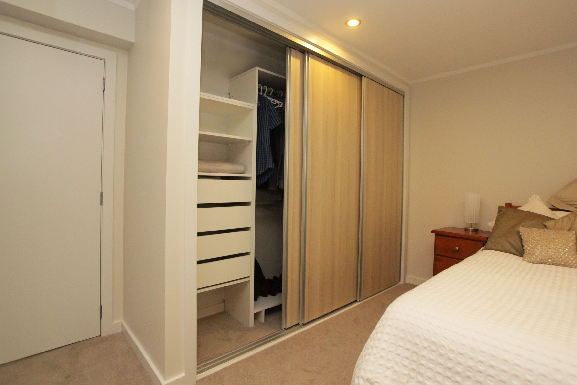 CUSTOM BUILT OAK WARDROBE & STORAGE  Features: Shelves and drawers, sliding doors and hanging space.