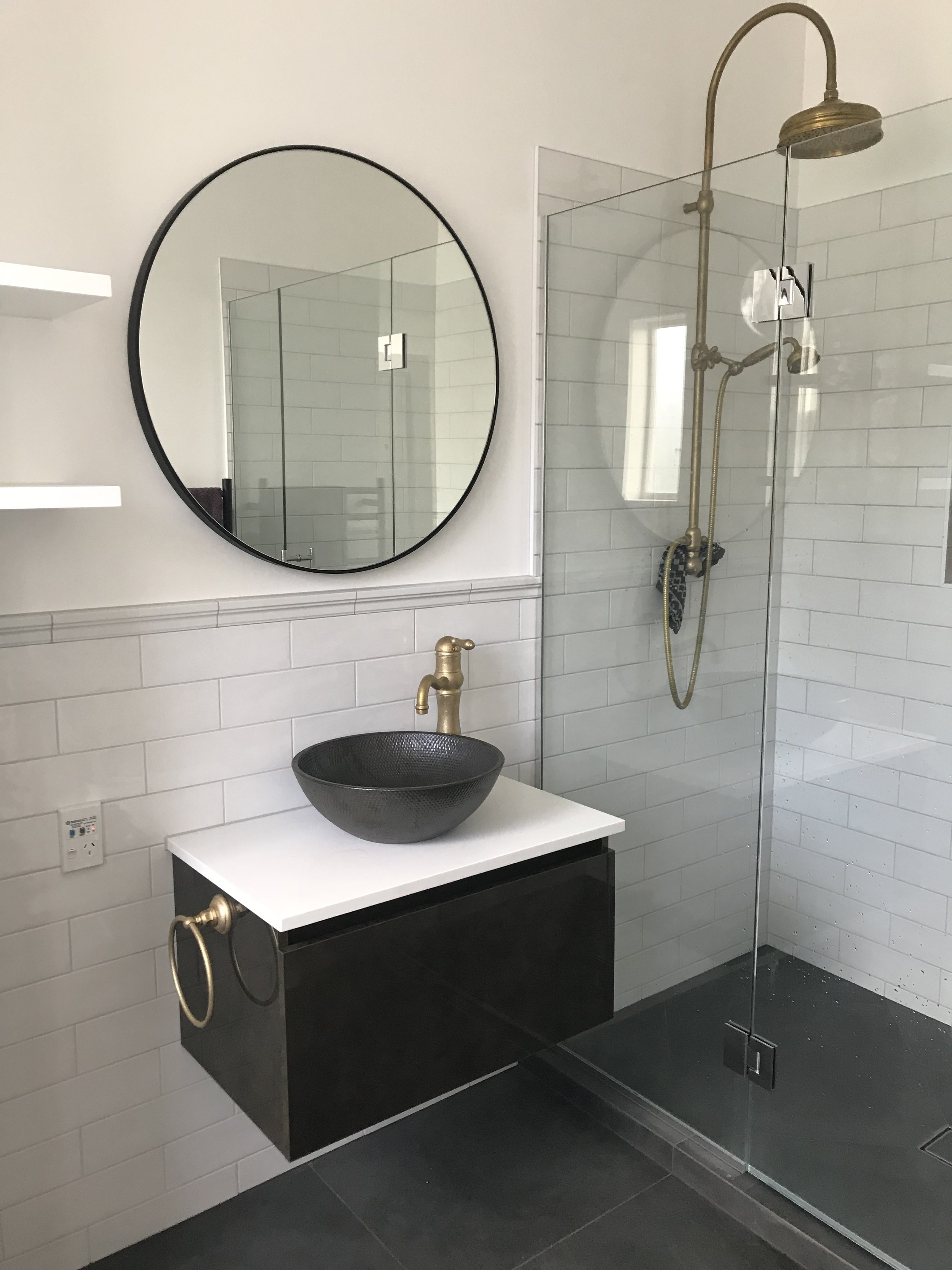 BATHROOM RENOVATION  Features: Subway Tiles, Brass Tapware, Brass Waterfall Showered, Raised Vanity and Bowl Style Basin.