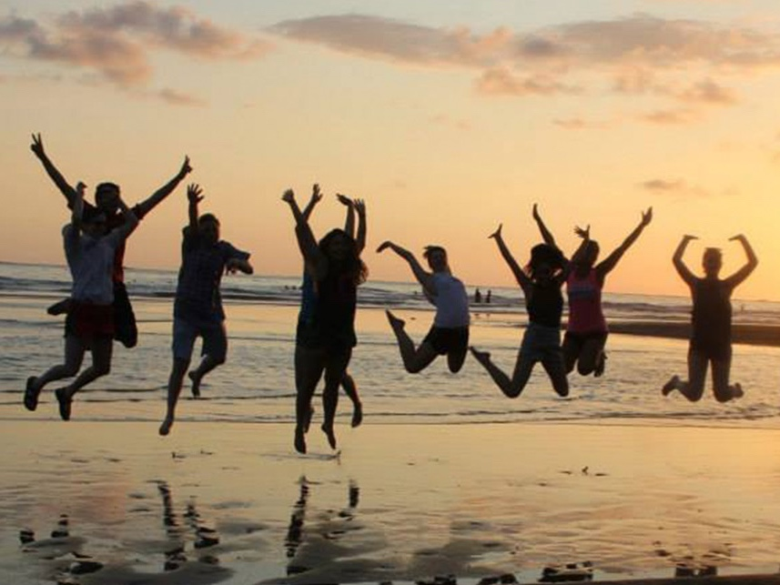 students-jumping-beach.jpg