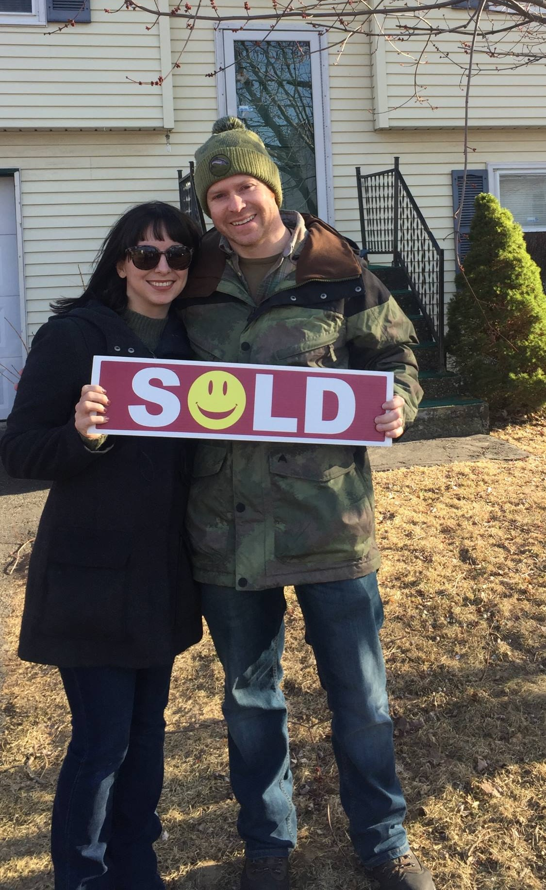 Couple with Sold Sign - 60 Days or Less Guarantee
