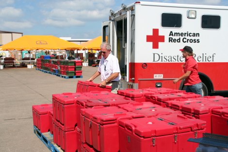 Food prepared by Southern Baptist Convention volunteers is loaded onto a Red Cross IRV for distribution in Galveston during Hurricane Ike. FEMA photo by Greg Henshall. Galveston, TX, October 10, 2008)