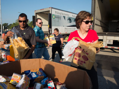 Volunteers from NASA's Johnson Space Center assist Galveston County Food Bank staff to sort relief items into trucks as part of ongoing public engagement with local non-profit organizations in Texas. September 6, 2016. Photo: Johnson Space Center, NA