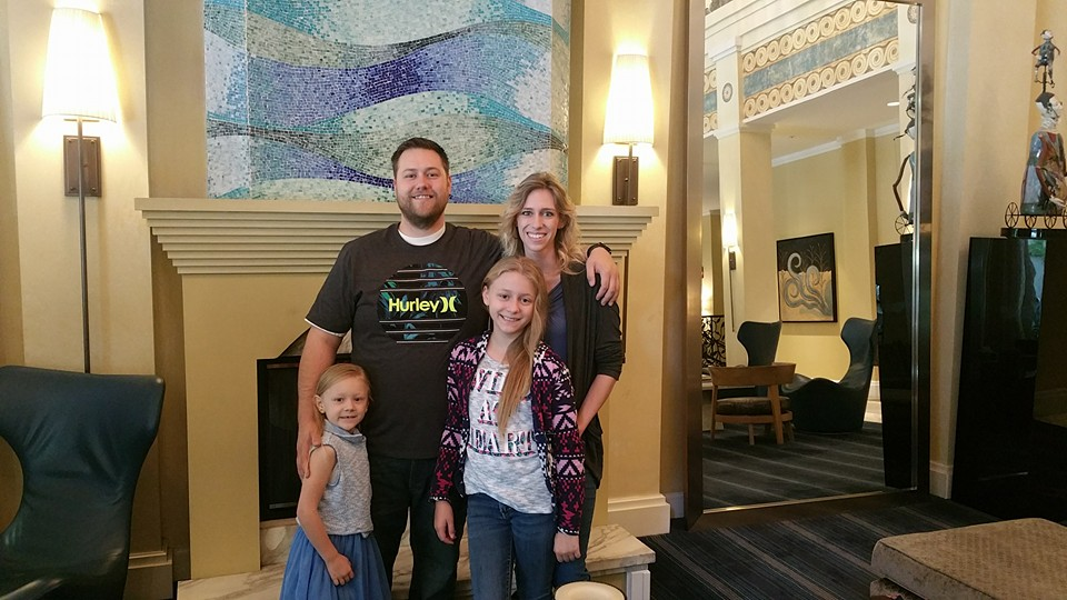 Mike Judd with his partner, Amber, and their two daughters