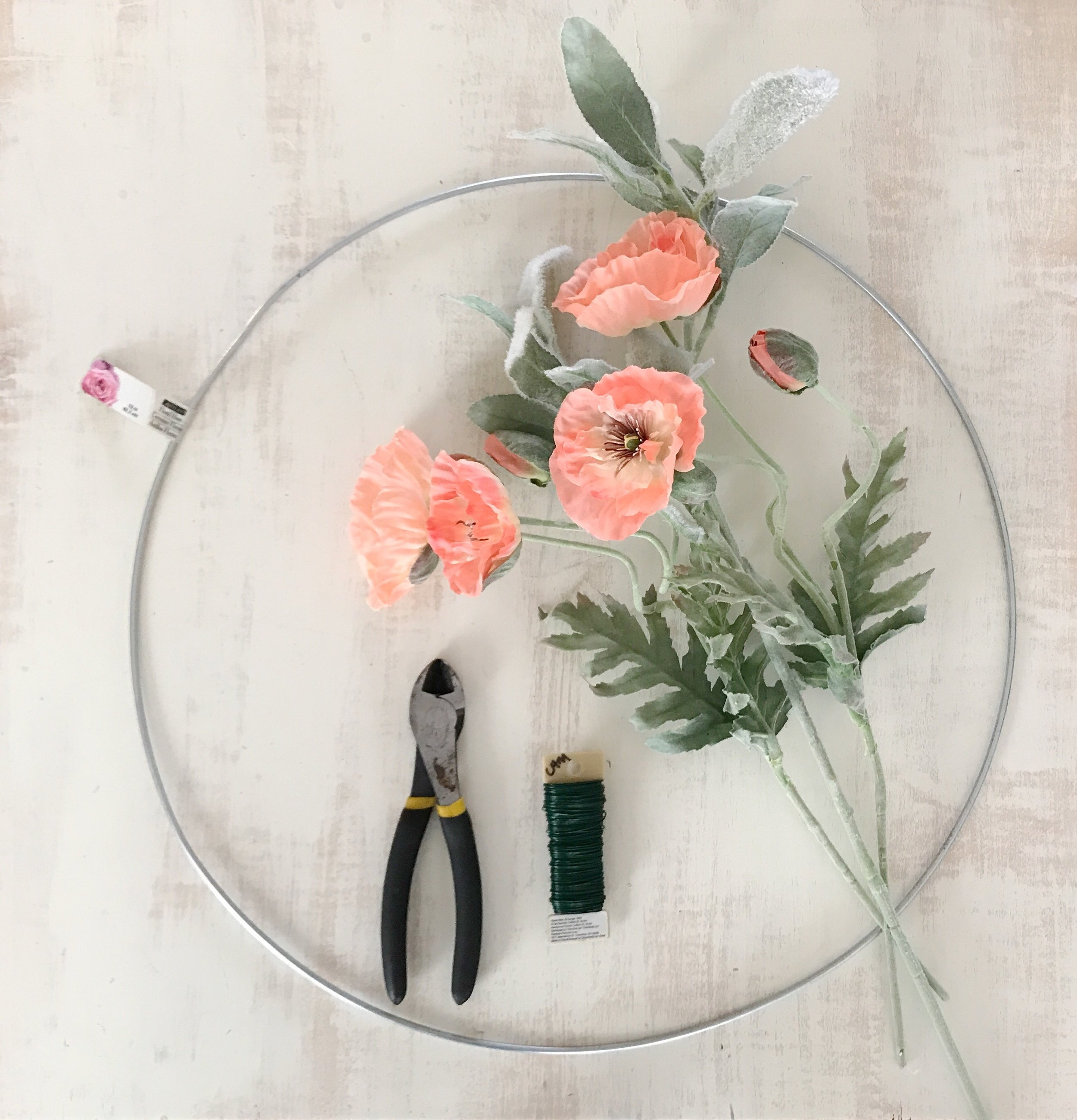 Supplies: - floral hoop, flowers, floral wire, wire cutters