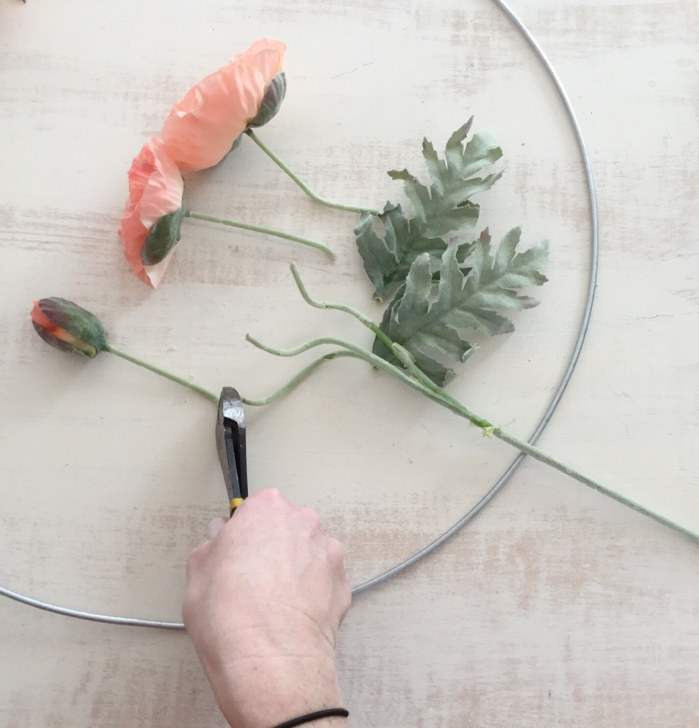 Step 1: Clip stems - Using a pair of wire cutters, clip the stems off of your flowers. Make sure to keep 2-3 inches of the stems in tact.