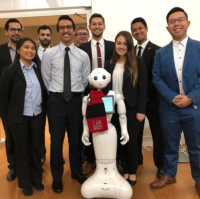SDSU AI Lab Students present robotics research to industry leaders.