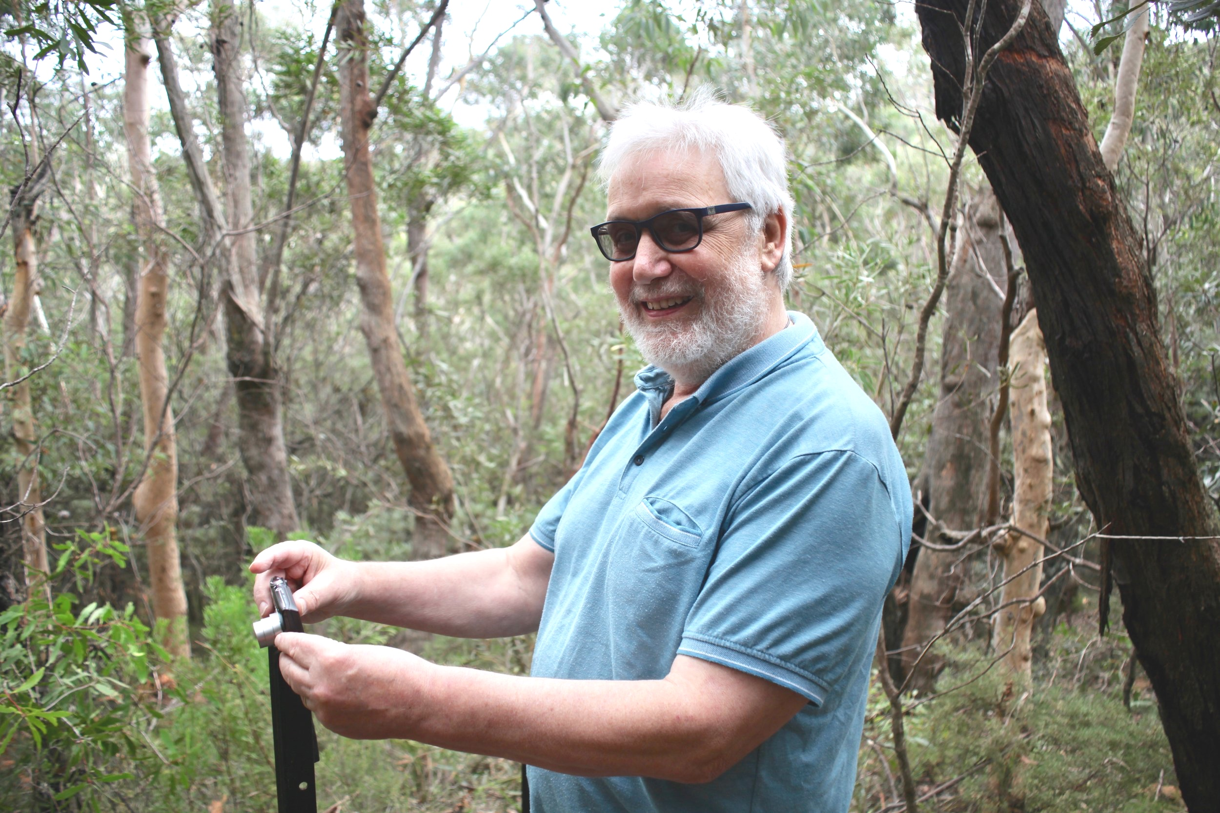 Frank Furlong, a volunteer citizen scientist records data near the Conservation Hut in Wentworth Falls.